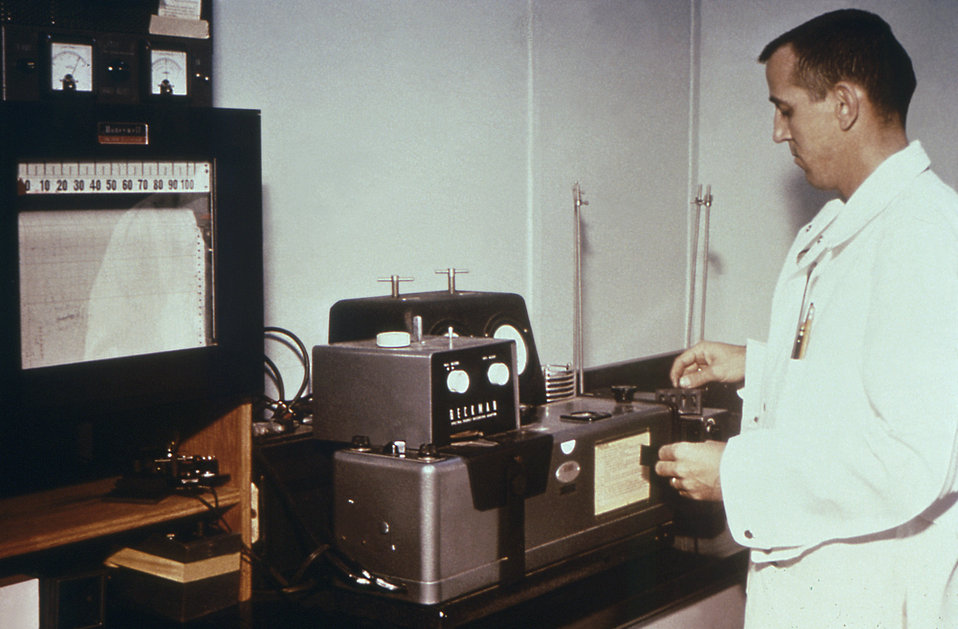 This 1974 photograph depicts a laboratorian conducting research in a CDC NIOSH facility.