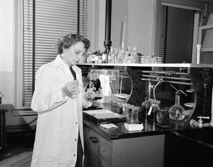This historic 1955 image depicted Dr. Marguerite Candler, as she was performing an experimental analysis, while in her Centers for Disease C