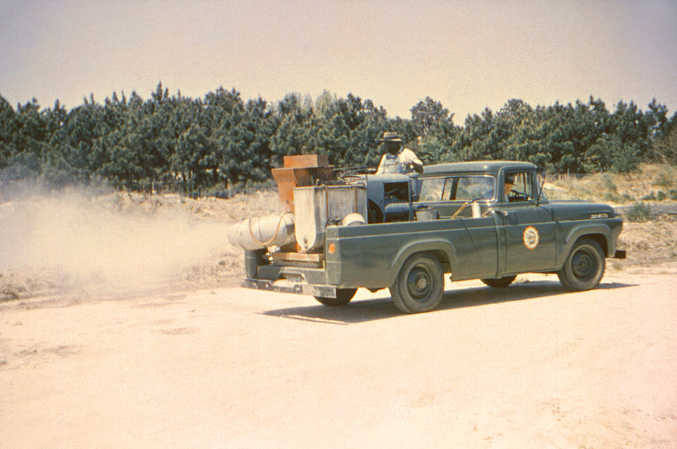 Driving a pick-up truck equipped with a Buffalo turbine blower, this historic 1962 image depicted two Rocky Mount, North Carolina men in the