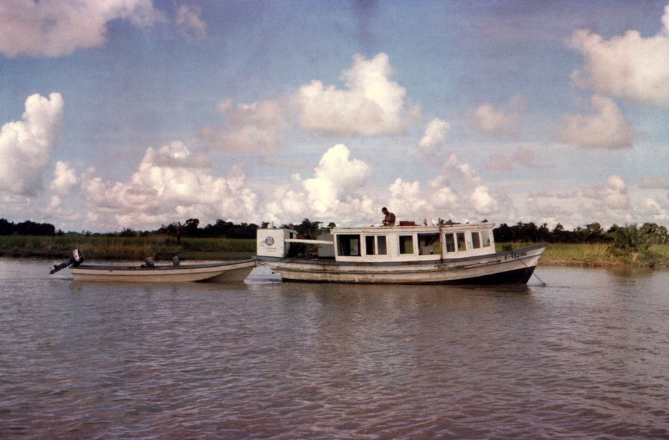 This October, 1975 photograph, depicted a 'UNICEF 8' boat in the act of towing a 'speedboat', on a Patuakhali District waterway, in the coun