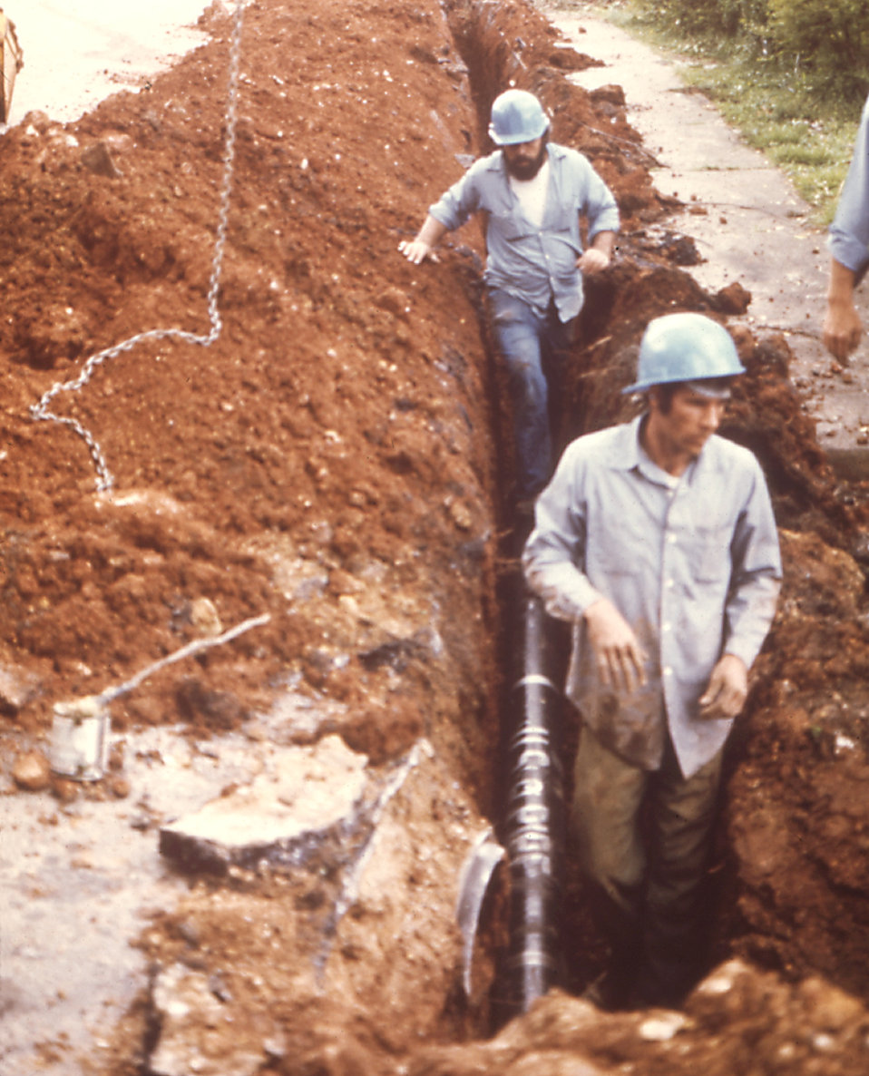 These workers were replacing a section of water pipes after a local chlordane contamination in a Chattanooga, TN, neighborhood.