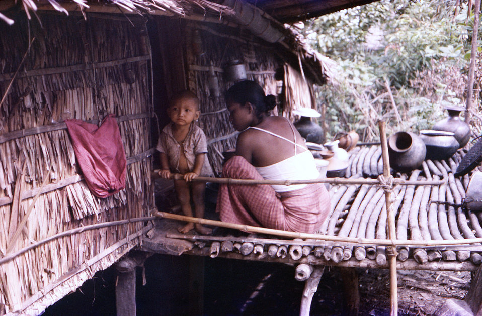 This October, 1975 photograph depicted a Burmese Buddhist woman caring for her child in a Patuakhali District, Marmas village, in the countr