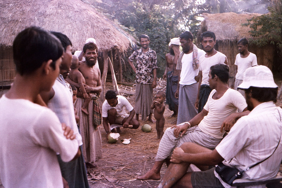 This October, 1975 photograph depicted smallpox eradication team member, Dave Forney, who was seated in a Patuakhali District village, in th