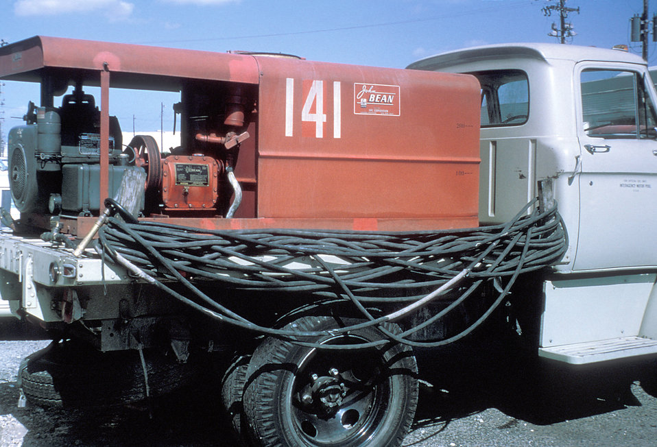 A photograph of a mosquito spray truck during the 1965 Aedes Aegypti eradication program in Miami, Florida.