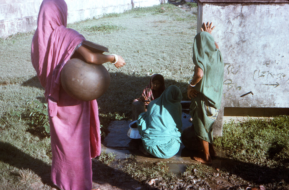 This October, 1975 image depicted a number of Bangladeshi village women, as they were gathered at a Patuakhali Town communal well. This site