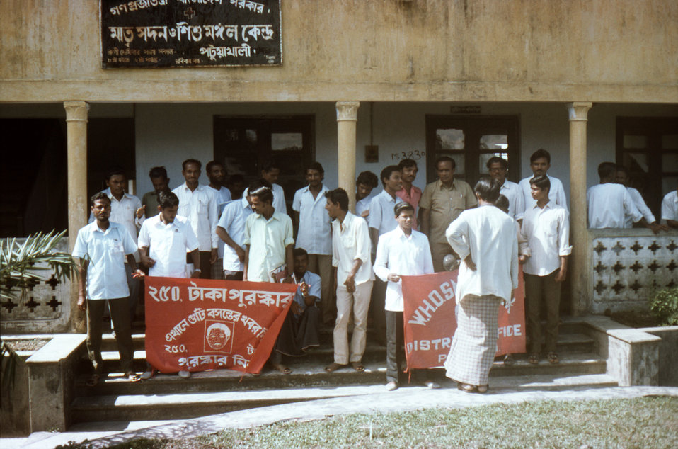 In this November, 1975 image, members of the Patuakhali District Surveillance Team, were preparing for a group photograph, after the Nationa