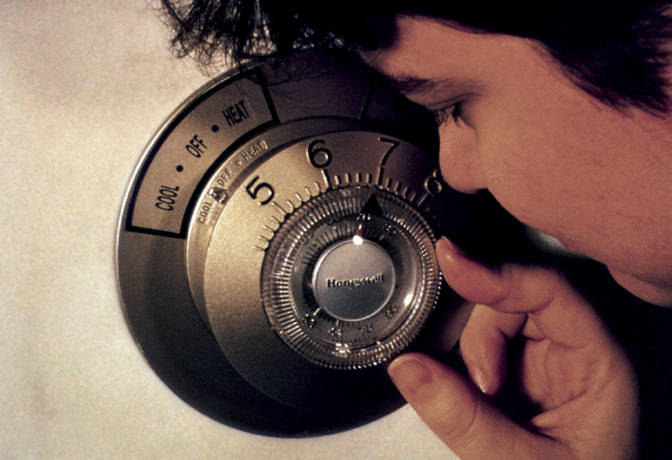 This 1997 image depicted a visually-impaired woman as she was using a thermostat that had been designed with features, which took into accou