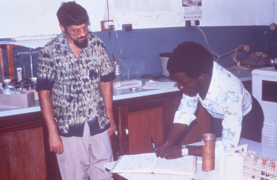 Here Dr. Joseph McCormick, CDC, (left) is in Segbwema, Sierra Leone during a Lassa fever investigation.