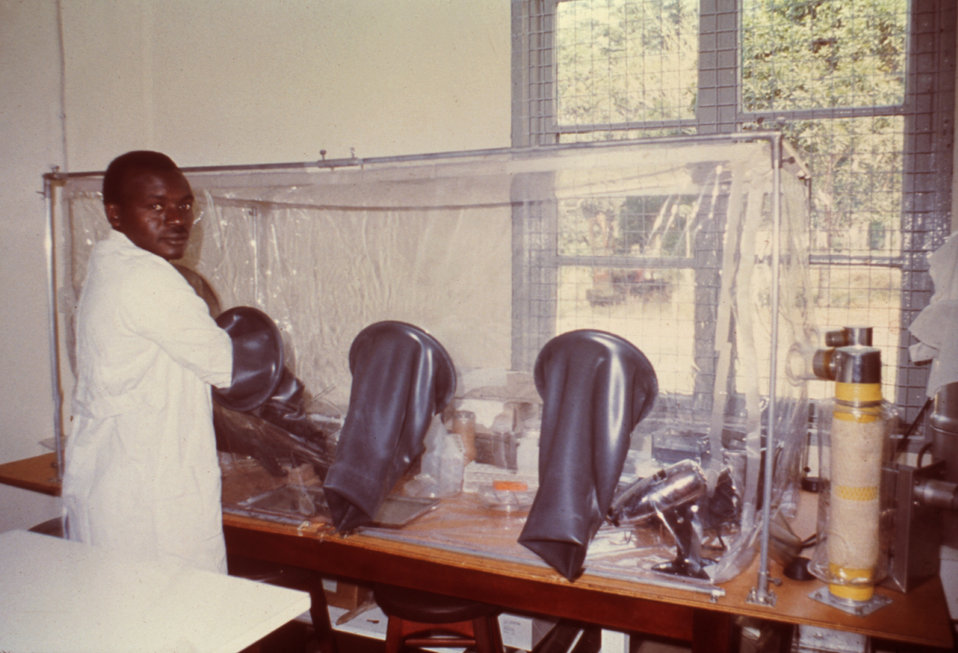 'Gabriel', a laboratory technician is seen here working in a Kenema, Sierra Leone lab during a Lassa fever investigation.