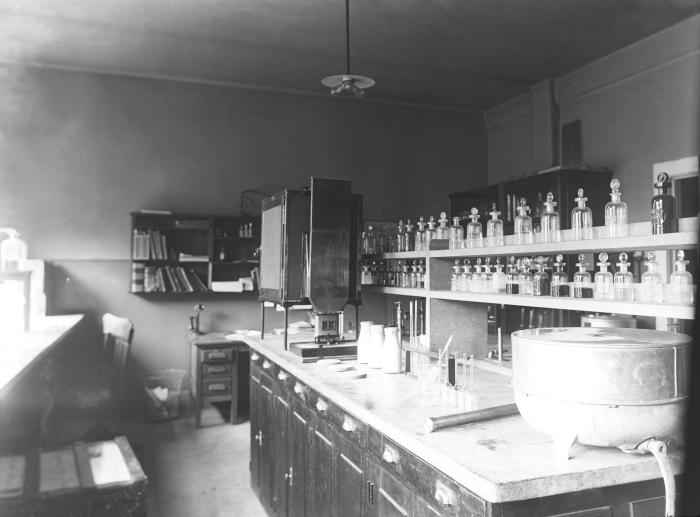 This historic 1919 photograph depicted the interior of a laboratory, and its inventory of portable laboratory testing equipment, used to det