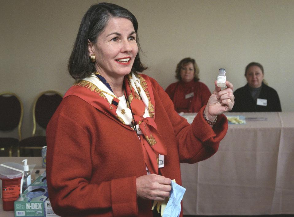 CDC clinician, Melanie King, RN, explains smallpox vaccine application during a 2002 Vaccinator Workshop.