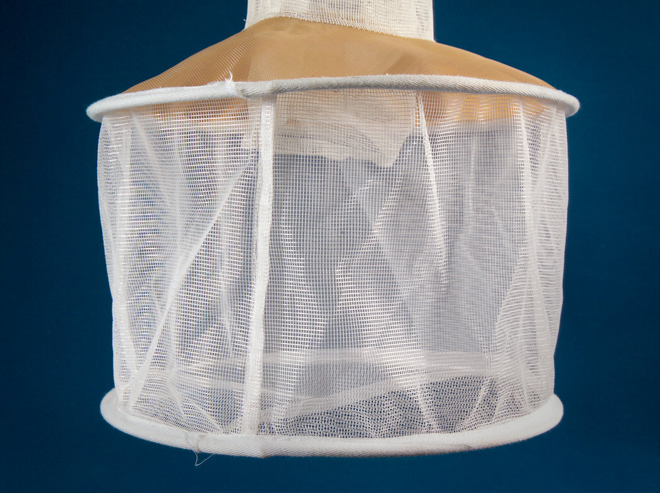 This is a frontal close-up of the light trap net compartment used to trap mosquitoes tested for the presence of pathogens.