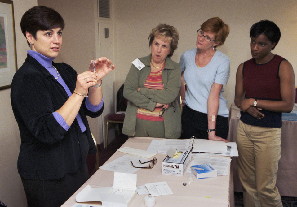 CDC Clinician, Joanne Cono, MD, describes the diluent syringe for smallpox vaccine during the 2002 Vaccinator Workshop.