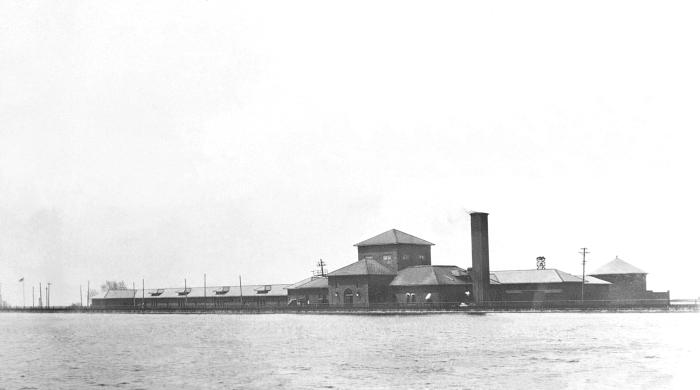 This historic 1917 photograph showed the exterior view of the Minneapolis municipal water filtration plant as seen from across an adjacent r