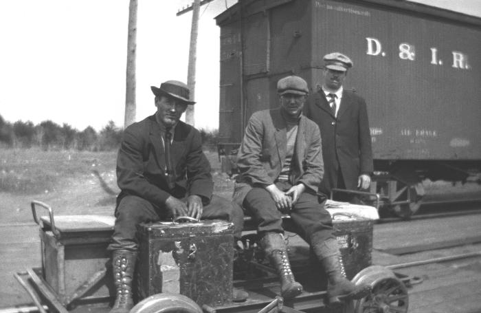 The three men posed in this historic 1916 photograph, were on their way to conduct field studies involving the acquisition, and testing of w