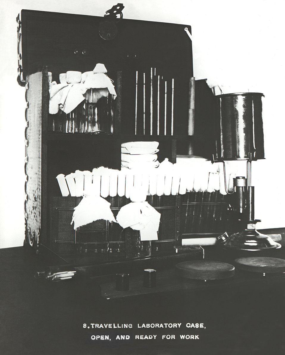 This 1916 photograph depicted a traveling laboratory case that had been opened, and its contents extracted, thereby, revealing the materials