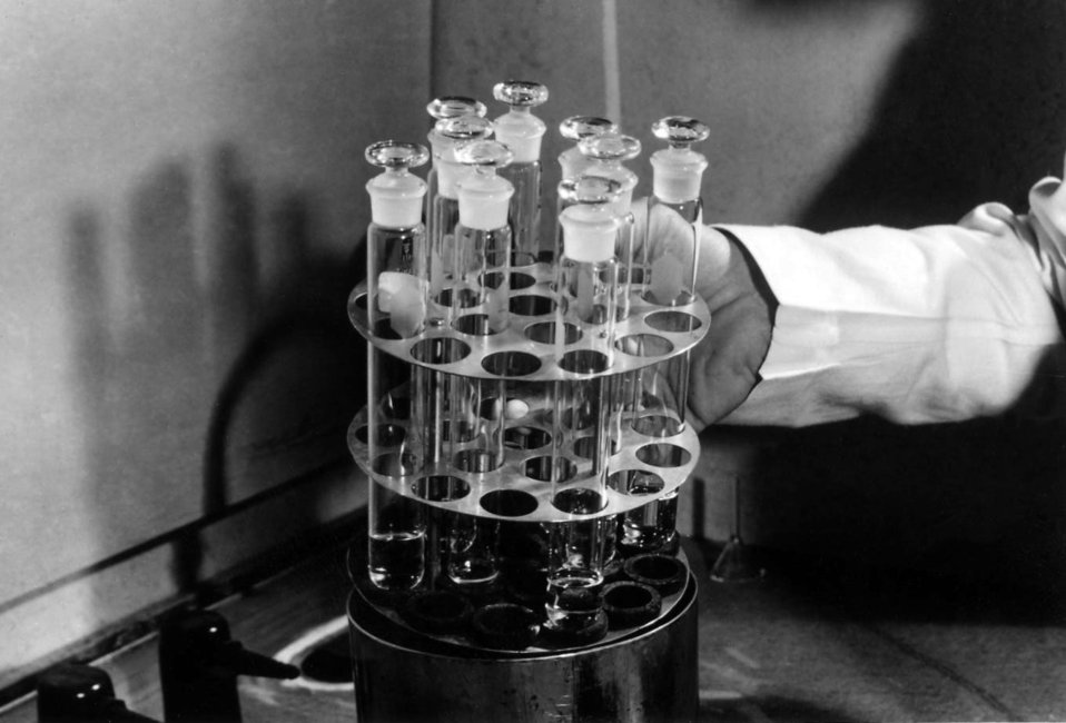This historic photograph showed a laboratorian as he was handling glass-stoppered test tubes in a Centers for Disease Control infectious dis