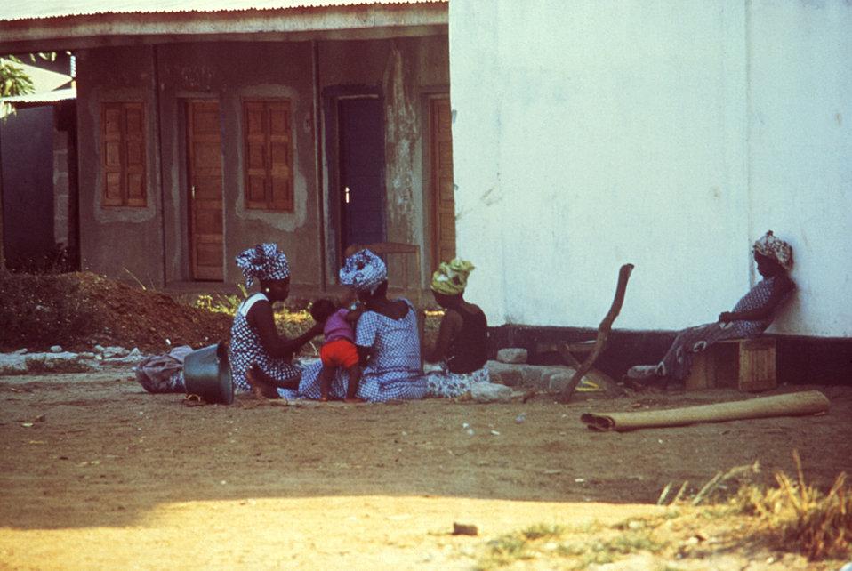 This 1977 group of Kenema, Sierra Leone women were here gathered while preparing a meal.