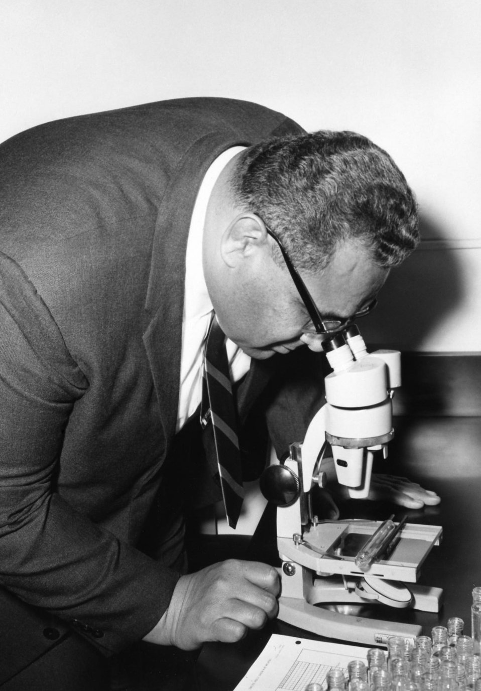 This 1967 photograph of Prince Tu'ipelehake of Tonga showed him looking into a microscope while on a tour of the Centers for Disease Control