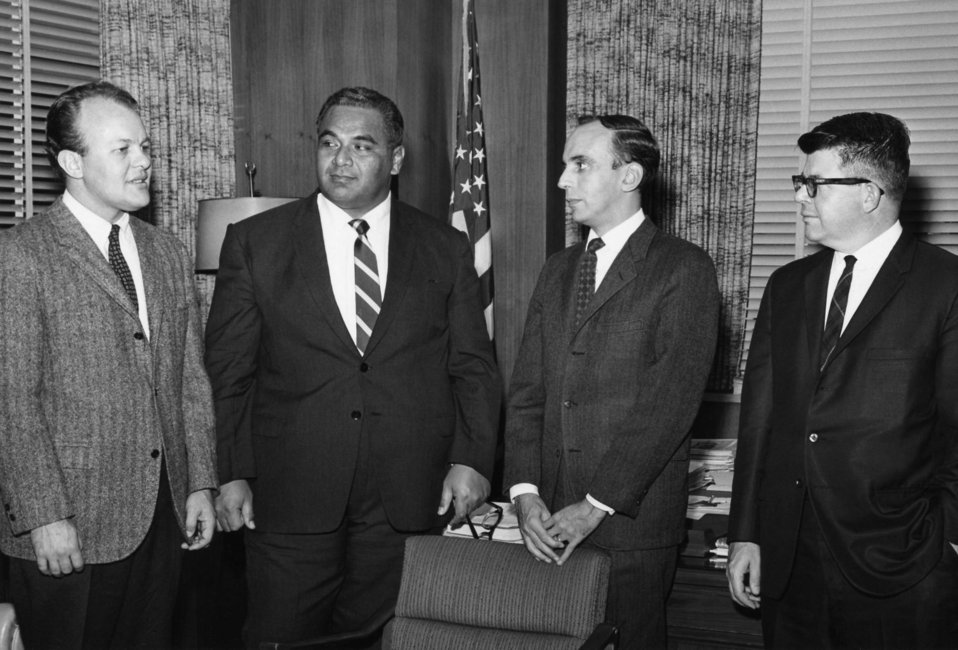 This historic 1967 photograph features (left to right) Dr. Ronald R. Roberto (EIS 1962), Prince Tu'ipelehake of Tonga, former Centers for Di