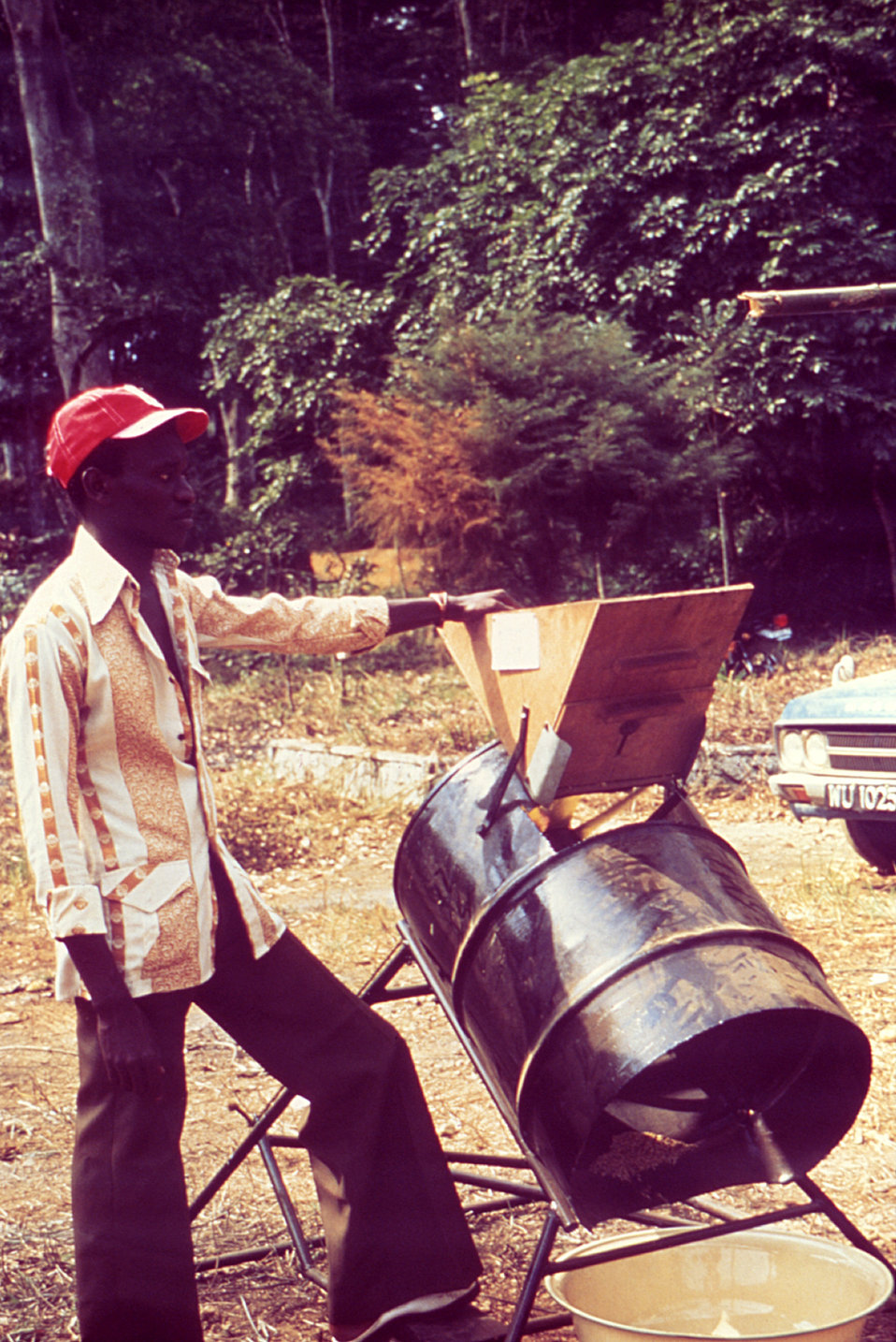 This image depicts a rice processing machine at the site of a 1976 Sierra Leone Lassa fever field study.