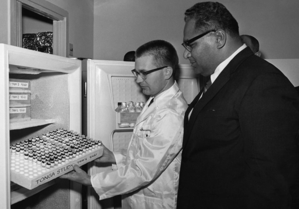 This photograph, taken during a 1967 visit to the Centers for Disease Control by the Prince Tu'ipelehake of Tonga, shows a CDC laboratorian