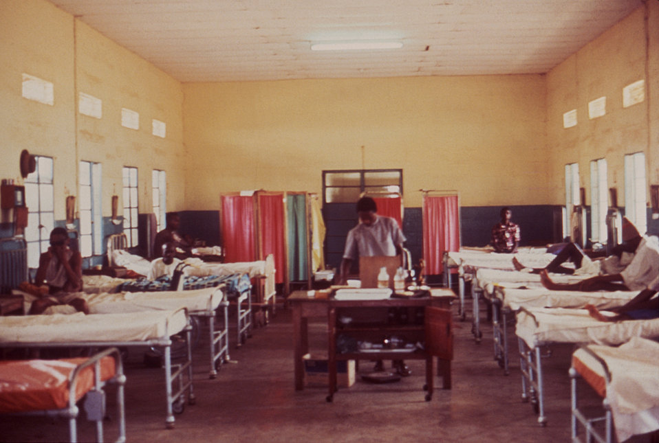 This 1977 image depicts the men's ward housing those affected by Lassa fever in Segbwema, Sierra Leone.