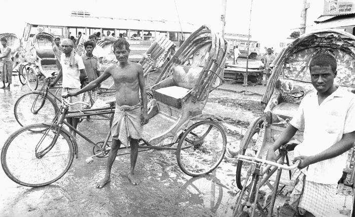 These Bangladeshi rickshaw drivers were photographed here as they were awaiting customers. This photograph provided by Dr. Stan Foster, and