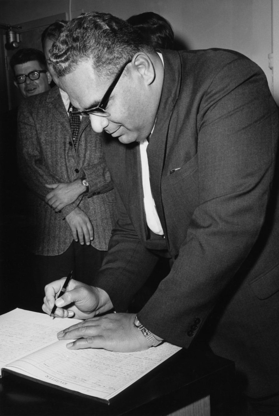 This photograph shows the Prince of Tonga, Prince Tu'ipelehake, as he was signing the guest registry during his 1967 visit to the Centers fo