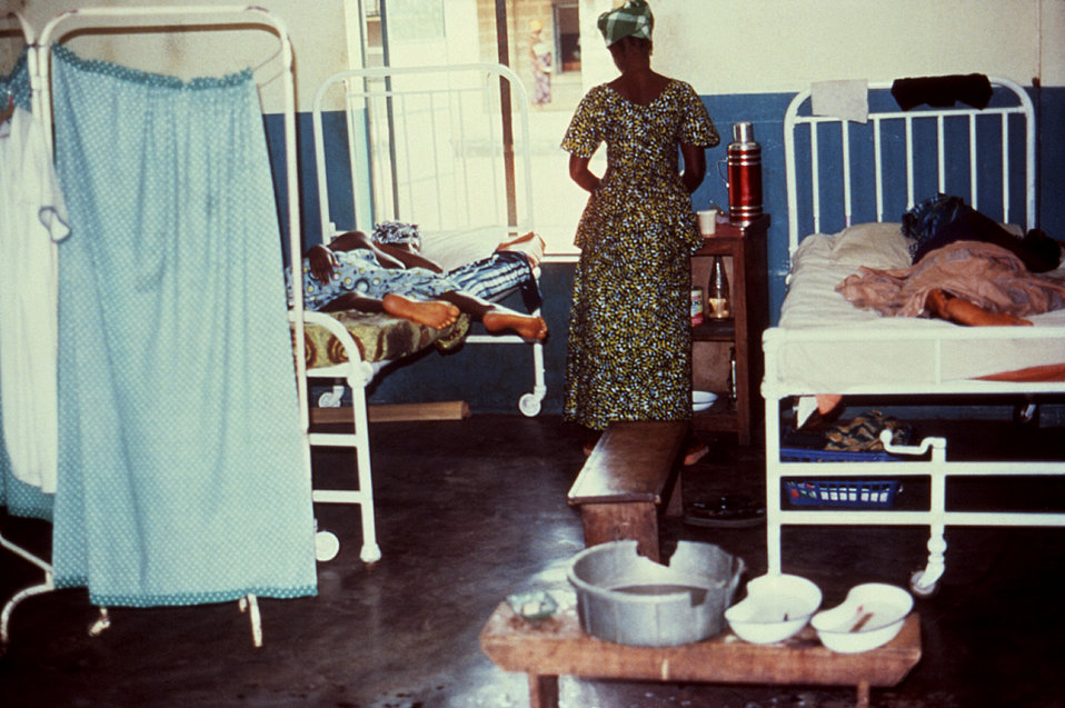 This 1977 image depicts recovering female Lassa fever patients in a Segbwema, Sierra Leone clinic.
