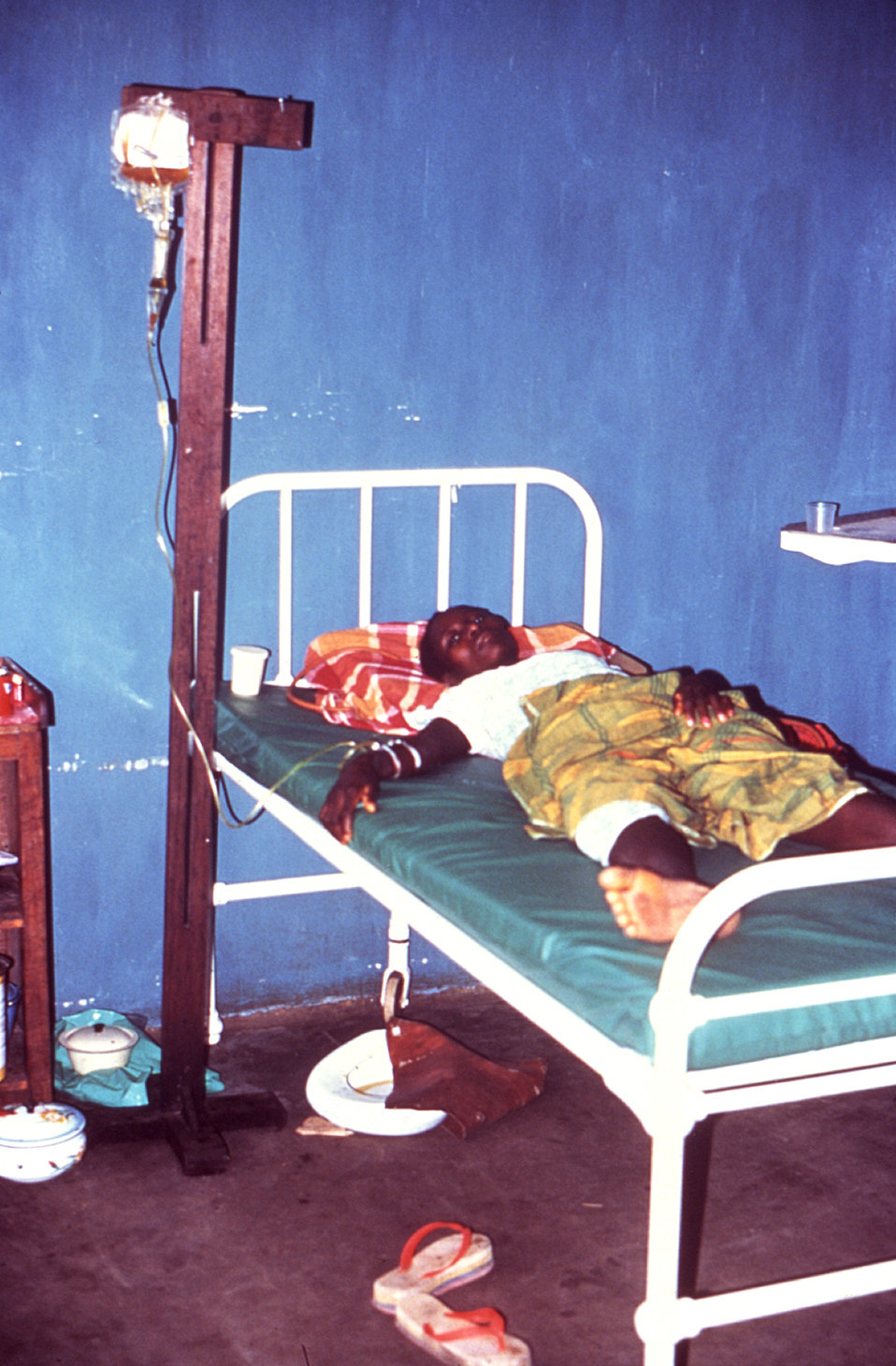This 1977 image depicts a Lassa fever patient as she receives crucial plasma in order to replenish her depleted blood volume.