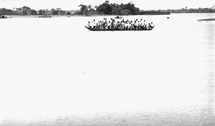This photograph depicted a 'boat taxi', which appeared to be overloaded, as it was transporting a large group of Bangladesh residents. This