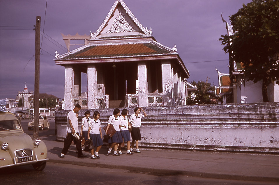This 1964 photograph depicts Bangkok, Thailand students in typical attire.