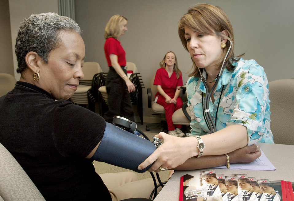 Connie Alfred (left), of the National Center for Infectious Diseases (NCID), was shown having her blood pressure taken by Robyn Morgan, of t