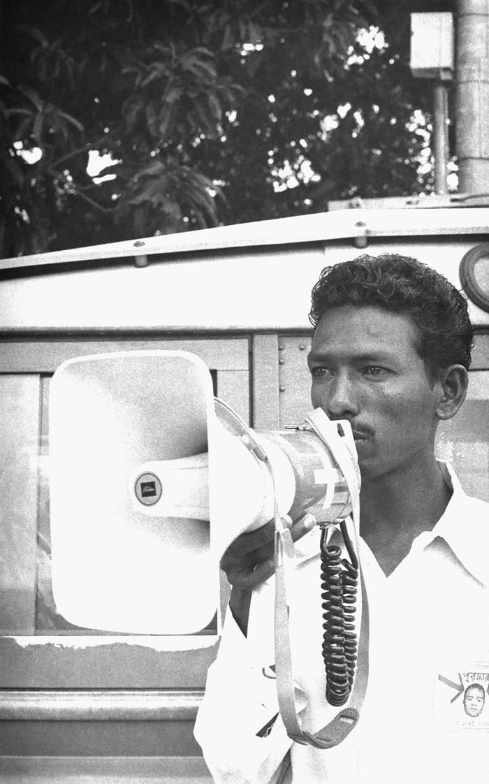 This local smallpox eradication team volunteer was using a handheld megaphone in order to notify villagers of the reward associated with rep