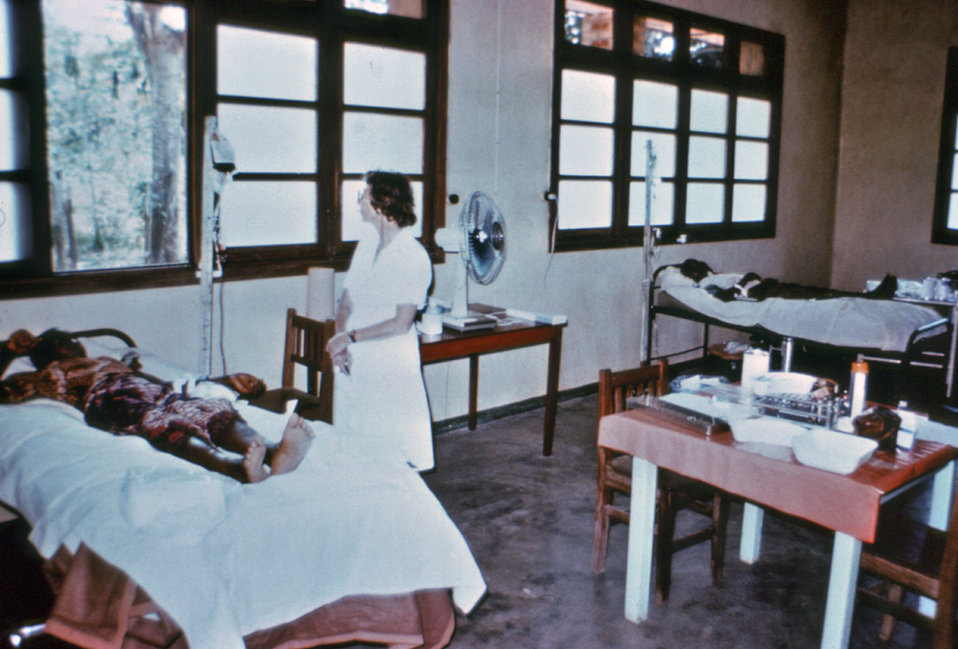 This photograph showed Dr. Margaret Isaacson as she was tending to the needs of an Ebola patient in a Yambuku, Zaire hospital theatre block