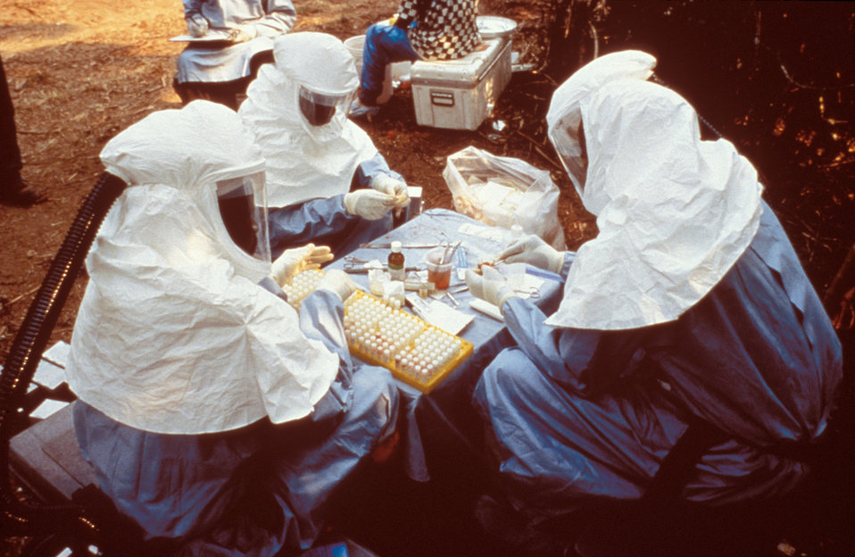 During a 1995 Ebola outbreak these CDC and Zairian scientists took samples from animals collected near Kikwit, Zaire.