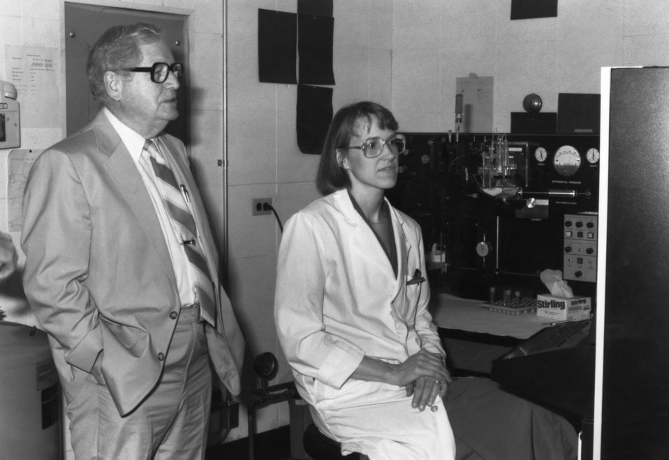 This 1986 photograph showed Dr. Otis Ray Bowen, standing next to one of the Centers for Disease Control's laboratorians, in a lab setting wh