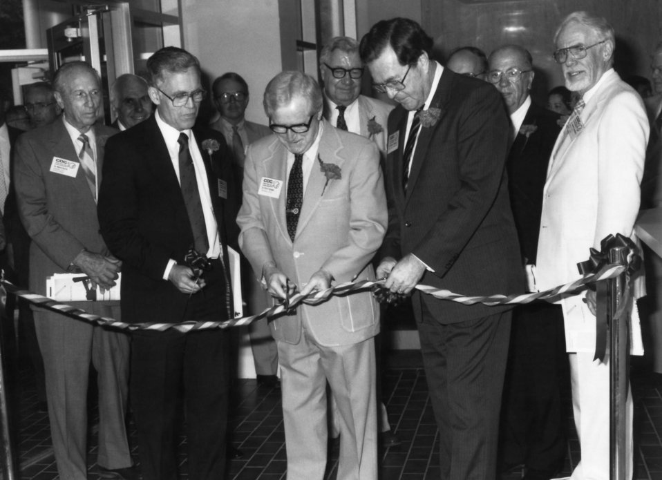 This 1986 photograph showed former Health and Human Services Secretary, Dr. Otis Ray Bowen (center), cutting a ribbon during the Centers for