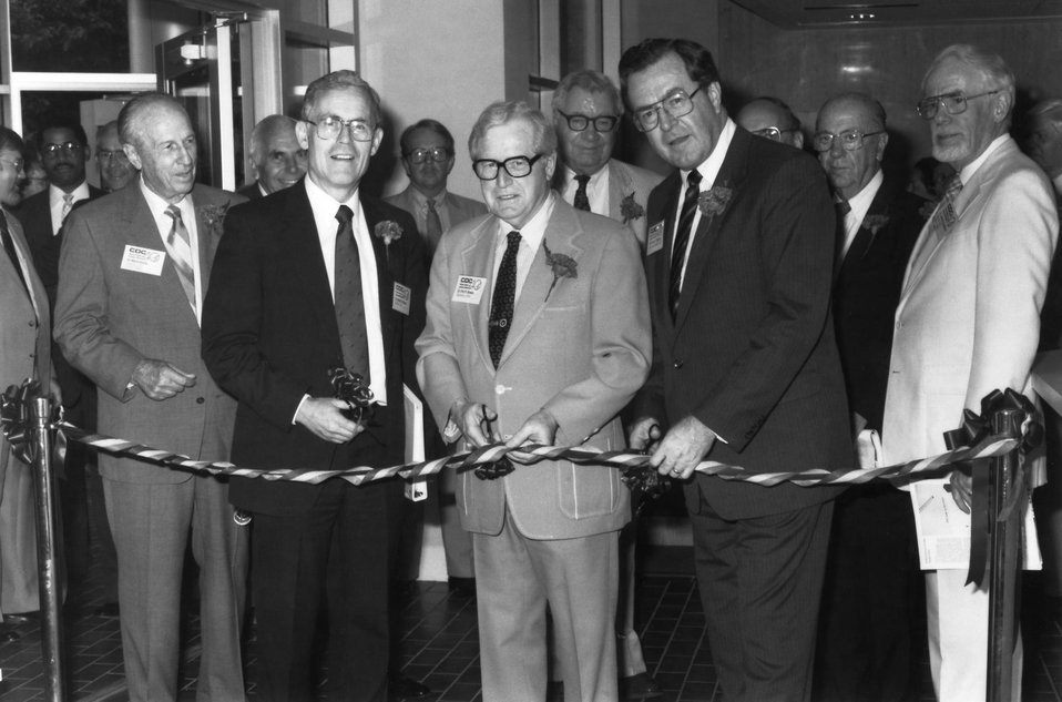 This 1986 photograph shows former Health and Human Services Secretary, Dr. Otis Ray Bowen (center), cutting a ribbon during the CDC's 40th a