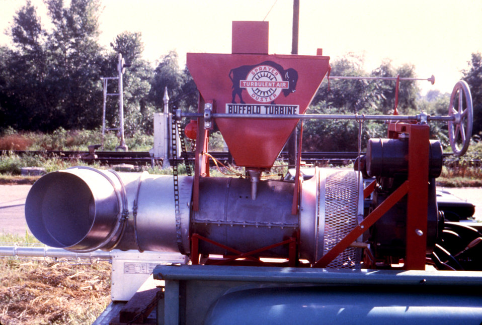 This 1981 photograph depicts a Buffalo Turbine Sprayer/Duster, which was used to distribute powdered insecticides outdoors, primarily amongs