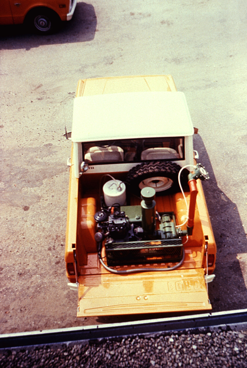 This 1981 image depicts a truck-mounted early model LECO-HD ULV (ultra-low volume) non-thermal fog generator.