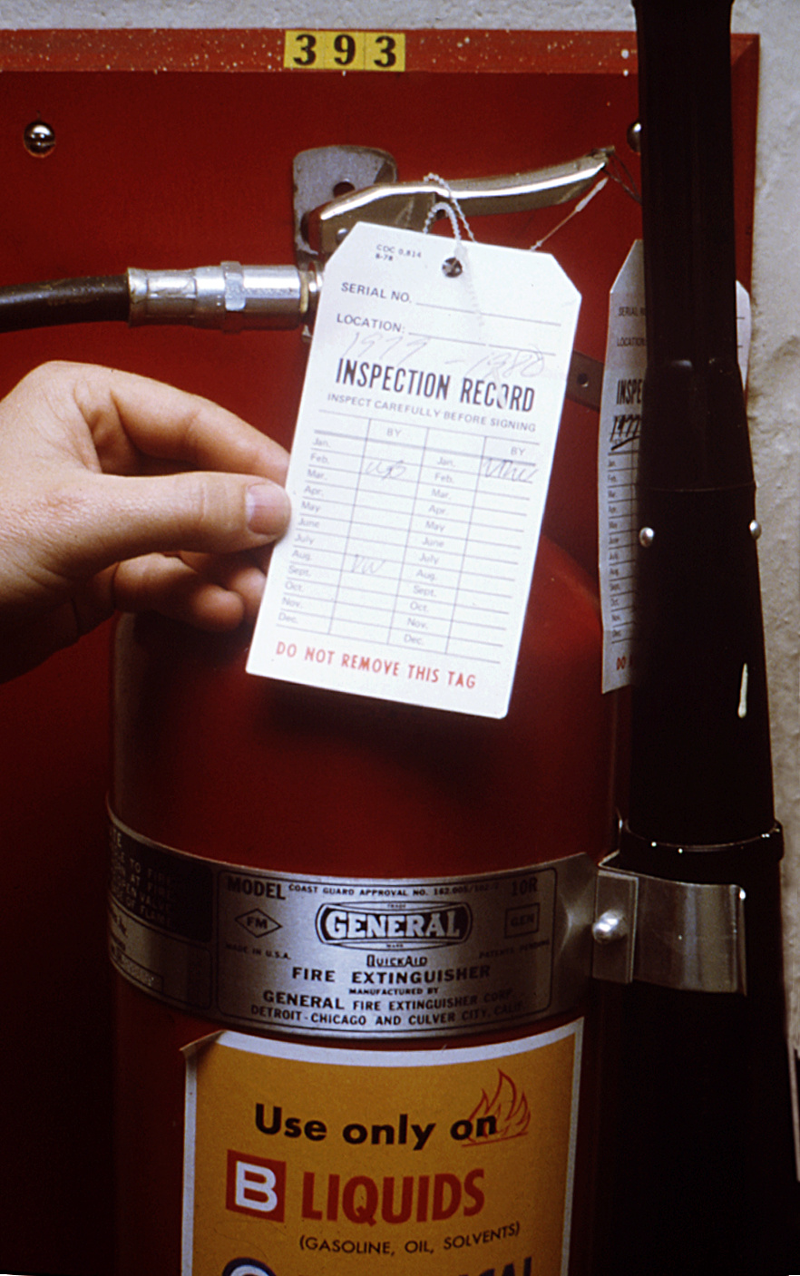 This photograph was taken during a safety equipment inspection, which included this fire extinguisher.