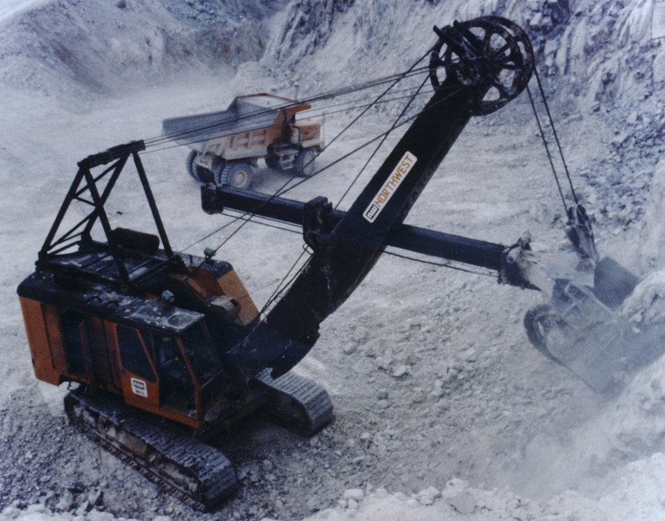 This 1970s photograph shows the loading of trucks to transport products for examination during a NIOSH study at a stone quarry.