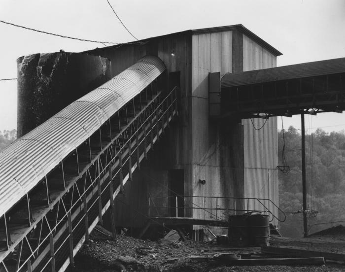 This late 1970s photograph of a transfer station was taken during a NIOSH study at a stone quarry.