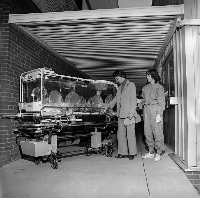 This 1981 image depicts a virtual 'patient', who was actually a healthy participant in a practice activity, walking as if she were ill, and