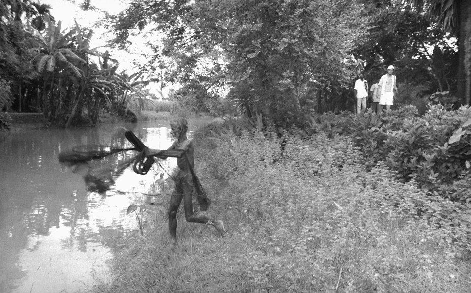 This man was casting his throw net into a local river, as on-duty public health smallpox investigators were searching out, and containing an