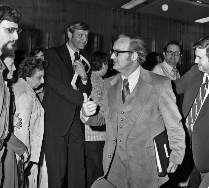 This April 5, 1977 photograph depicts former CDC Director William H. Foege, M.D., M.P.H., (left of center) while attending a reception after