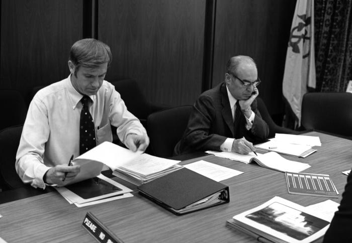 This 1977 photograph depicts former Centers for Disease Control and Prevention Director William H. Foege, M.D., M.P.H. (left) as he was anal
