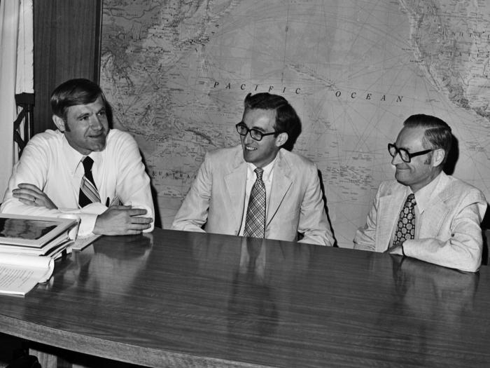 This 1977 photograph depicted former Centers for Disease Control and Prevention Director William H. Foege, M.D., M.P.H. (left) seated at a d
